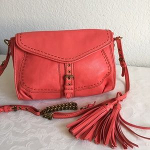 Isabella Fiore coral crossbody bag with tassels